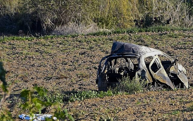 The wreckage of the car of investigative journalist Daphne Caruana Galizia lies next to a road in the town of Mosta, Malta, Monday, Oct. 16, 2017. (AP Photo/Rene Rossignaud)
