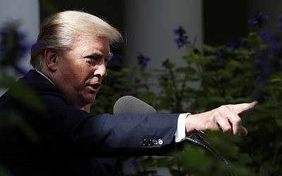 US President Donald Trump points to a reporter to ask a question during a media availability in the Rose Garden, October 16, 2017, in Washington. (AP Photo/Alex Brandon)