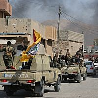 Iraqi security forces and Popular Mobilization Forces patrol in Tuz Khormato, that was evacuated by Kurdish security forces, 130 miles north of Baghdad, Iraq, Monday, Oct. 16, 2017. (AP Photo)