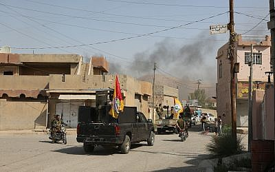 Iraqi security forces and the mostly-Shiite Popular Mobilization Forces patrol in Tuz Khormato, that was evacuated by Kurdish security forces, 130 miles north of Baghdad, Iraq, October. 16, 2017. (AP)