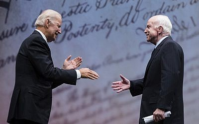 US Senator John McCain, R-Arizona.,right, shakes hands with chair of the National Constitution Center's Board of Trustees, former Vice President Joe Biden after receiving the Liberty Medal in Philadelphia, October 16, 2017. (AP/Matt Rourke)