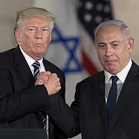 Prime Minister Benjamin Netanyahu, right, and US President Donald Trump shake hands at the Israel Museum in Jerusalem, May 23, 2017. (AP/Sebastian Scheiner)