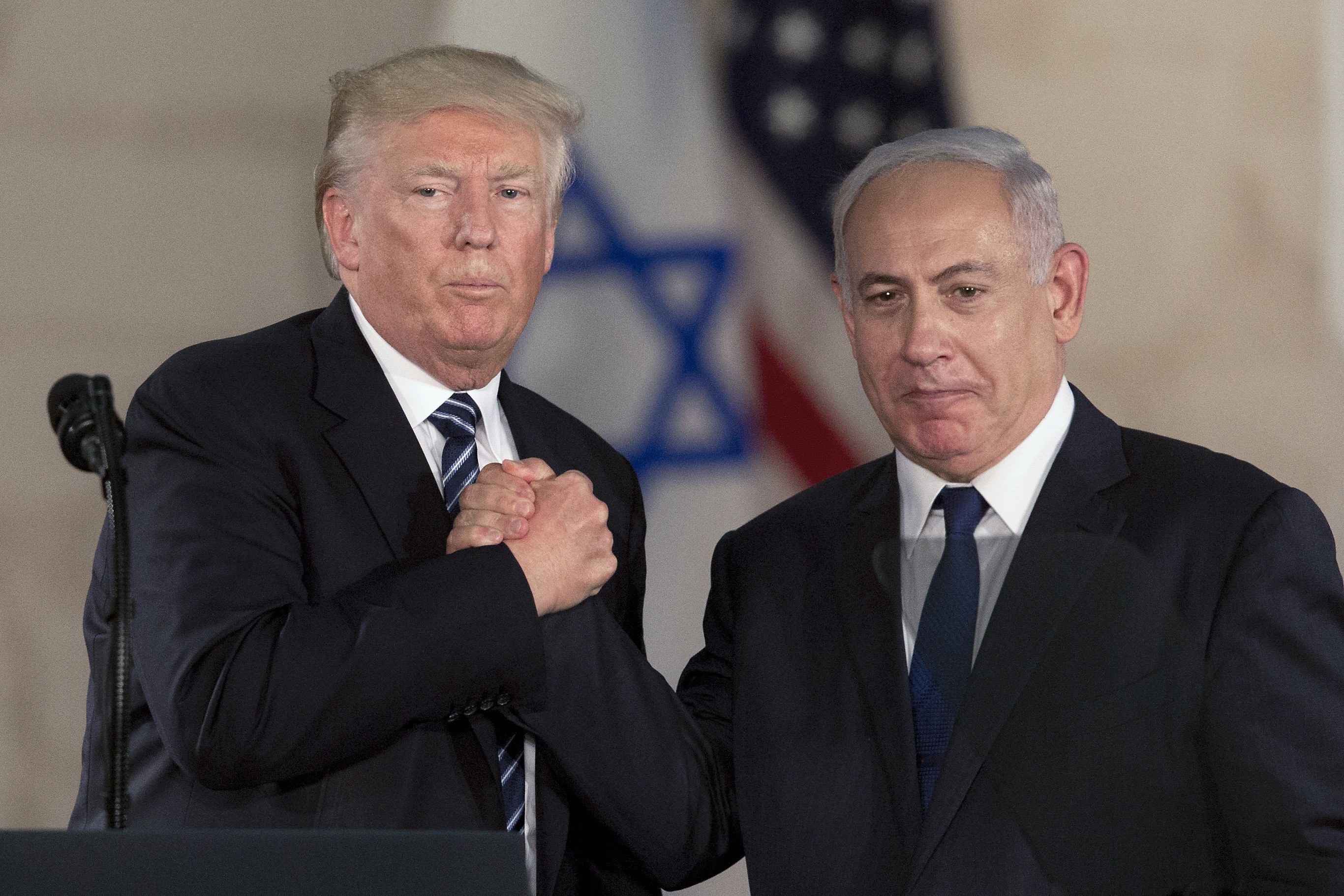 Prime Minister Benjamin Netanyahu, right, and US President Donald Trump  shake hands at the