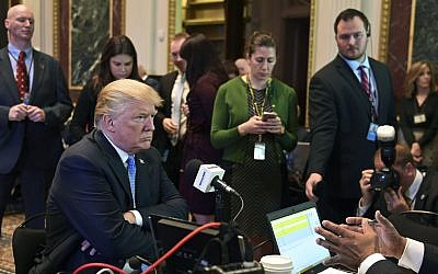 US President Donald Trump sits for a radio interview in the Eisenhower Executive Office Building in the White House complex in Washington, Tuesday, Oct. 17, 2017. (AP Photo/Susan Walsh)
