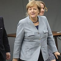German Chancellor Angela Merkel arrives for a meeting of the European People's Party prior to an EU summit in Brussels on October 19, 2017. European Union leaders are gathering for a two day summit to discuss migration, digital economy and Brexit. (AP Photo/Olivier Matthys)