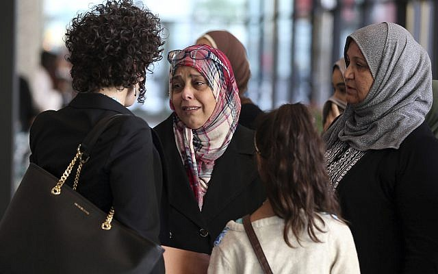 Supporters of Abdella Ahmad Tounisi leave the Dirksen US Courthouse in Chicago on October 19, 2017, after Tounisi was sentenced to 15 years in prison. (Terrence Antonio James/Chicago Tribune via AP)
