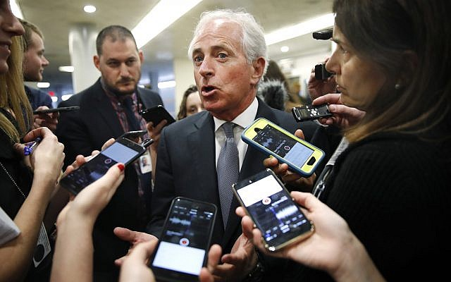 Sen. Bob Corker, R-Tennessee, speaks to reporters while heading to vote on budget amendments, Thursday, October 19, 2017, in Washington. (AP Photo/Jacquelyn Martin)