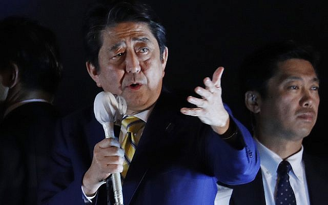 Japan's Prime Minister and head of the ruling Liberal Democratic Party Shinzo Abe delivers a speech to the crowd in support for his party's candidate during an election campaign for the upcoming lower house election in Tokyo. (AP Photo/Eugene Hoshiko)
