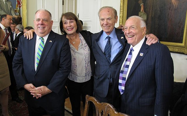 Maryland Gov. Larry Hogan, left, poses with Goody Finkelstein, former Del. Richard Rynd and lobbyist Bruce Bereano after a news conference on Monday, Oct. 23, 2017, in Annapolis, Maryland. (AP Photo/Brian Witte)