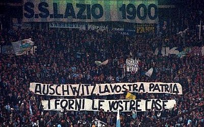 "In this November 29, 1998, photo, Lazio fans display banners from the stands reading ""Auschwitz is Your Homeland. The Ovens are Your Homes"" during a Serie A match between Lazio and AS Roma, at Rome's Olympic stadium. (AP Photo/Plinio Lepri, files)"