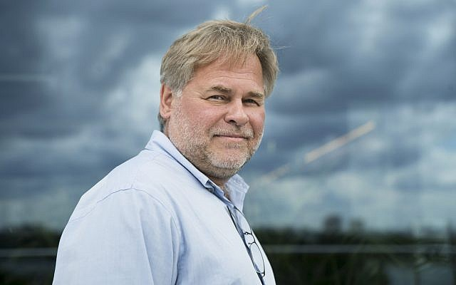 Eugene Kaspersky, Russian antivirus programs developer and chief executive of Russia's Kaspersky Lab, poses for a photo on a balcony at his company's headquarters in Moscow, Russia,  July 1, 2017. (AP/Pavel Golovkin)