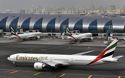 In this Wednesday, March 22, 2017 photo, an Emirates plane taxis to a gate at Dubai International Airport at Dubai International Airport in Dubai, United Arab Emirates. (AP Photo/Adam Schreck, File)