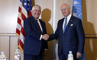 US Secretary of State Rex Tillerson, left, shakes hands with UN Special Envoy for Syria Staffan de Mistura before their meeting at the US Mission to the UN, in Geneva, Switzerland, October 26, 2017. (AP/Alex Brandon)