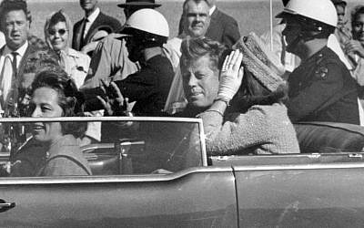 President John F. Kennedy waves from his car in a motorcade in Dallas moments before his assassination, November 22, 1963. (AP/Jim Altgens, File)