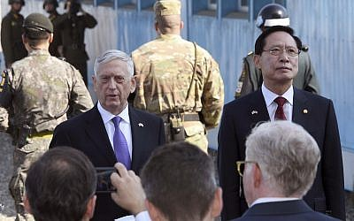 US Defense Secretary Jim Mattis, center, speaks to the media as South Korean Defense Minister Song Young-moo, right, looks on during a visit to the truce village of Panmunjom in the Demilitarized Zone (DMZ) on the border between North and South Korea Friday, Oct. 27, 2017 (Jung Yeon-je/Pool Photo via AP)