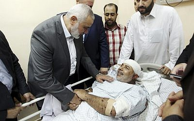 In this photo released by the Hamas media office, Ismail Haniyeh, head of the Hamas terror group's political bureau, visits Tawfiq Abu Naim at Shifa Hospital in Gaza City on October 27, 2017. (Mohammad Austaz, Hamas Media Office via AP)