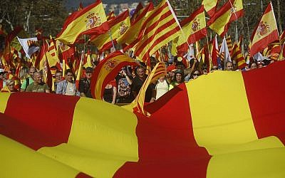 Nationalist activists protest with Spanish and Catalan flags during a mass rally against Catalonia's declaration of independence, in Barcelona, Spain, on October 29, 2017. (AP Photo/Santi Palacios)