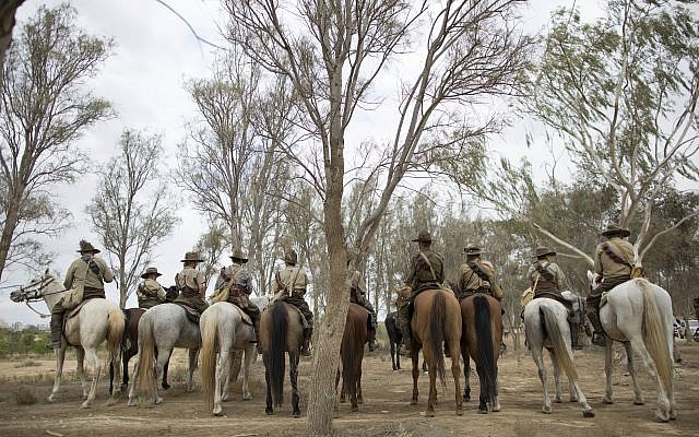 History enthusiasts and descendants of Australian Mounted Division and ANZAC (Australian and New Zealand Mounted Division) Mounted Division soldiers ride their horses during the reenactment of the Battle of Beersheba when British and ANZAC forces captured Beersheba from the Ottoman Empire during the World War I, as part of the 100 years anniversary in near Beersheba, southern Israel, Monday, Oct. 30, 2017. (AP Photo/Oded Balilty)