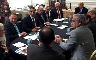 In this photo from US President Donald Trump's Twitter account, George Papadopoulos, third from left, sits at a table with then-candidate Trump and others at what is labeled at a national security meeting in Washington that was posted on March 31, 2016. (Donald Trump's Twitter account via AP)