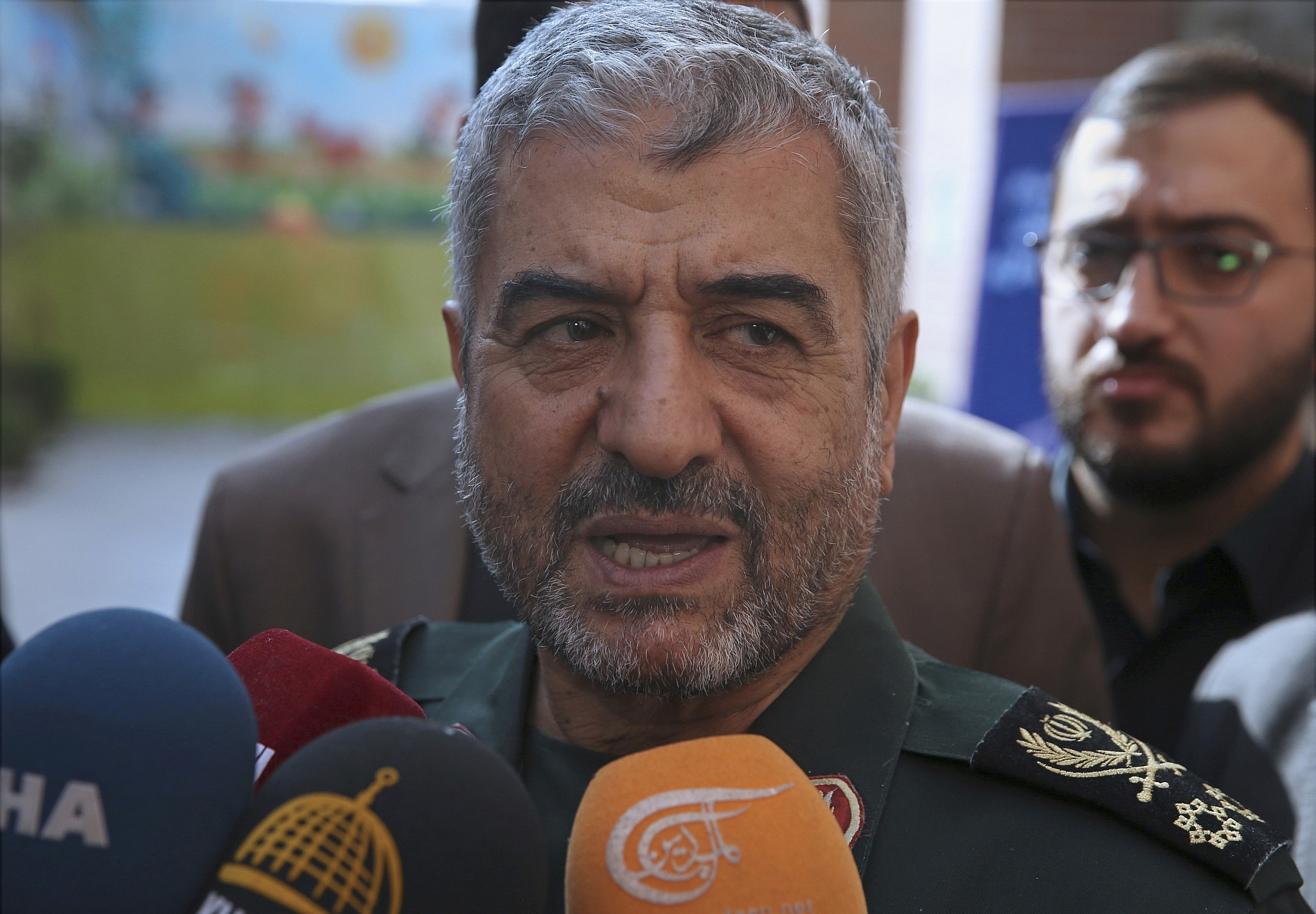 The head of Iran's paramilitary Revolutionary Guard General Mohammad Ali Jafari speaks to journalists after his speech at a conference called
