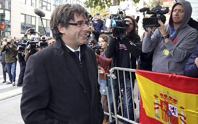 Sacked Catalonian President Carles Puigdemont arrives for a press conference in Brussels, October 31, 2017. (AP/Olivier Matthys)