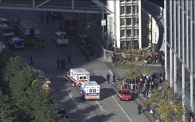 In this still image taken from video, police and ambulances respond to report of gunfire a few blocks from the World Trade Center in New York on Tuesday, Oct. 31, 2017. (AP Photo)