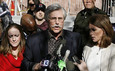 Fred Goldman, center, father of Ron Goldman, who was murdered in 1994, speaks to reporters after O.J. Simpson's sentencing hearing outside the Clark County Regional Justice Center in Las Vegas,  December 5, 2008. (AP Photo/Isaac Brekken, Pool)