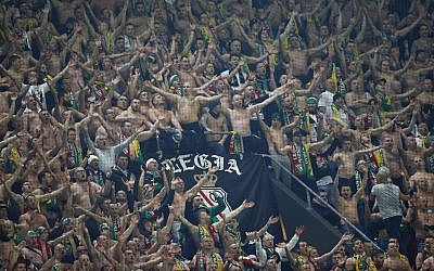 Legia fans during a Europa League match between Ajax and Legia at the Amsterdam ArenA stadium in Amsterdam, Netherlands, Thursday, February 23, 2017. (AP Photo/Peter Dejong)