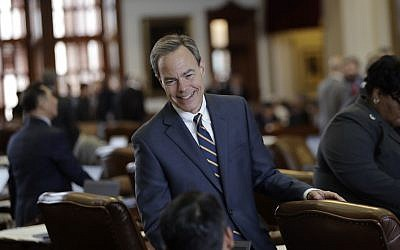 Texas Speaker of the House Joe Straus, R-San Antonio, talks with fellow law makers on the House floor at the Texas Capitol, April 19, 2017, in Austin, Texas. (AP Photo/Eric Gay)