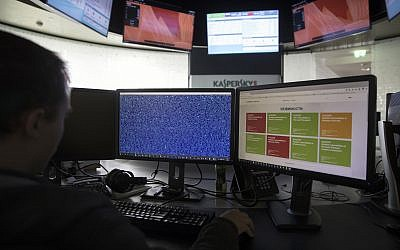 An employee of Kaspersky Lab works on computers at the company's headquarters in Moscow, Russia, July 1, 2017. (AP Photo/Pavel Golovkin)