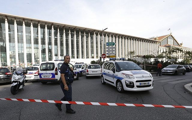 A French police officer cordons off the access to Marseille's main train station Sunday, Oct. 1, 2017 in Marseille, southern France.A French police officer cordons off the access to Marseille's main train station Sunday, Oct. 1, 2017 in Marseille, southern France. French police have warned people to avoid Marseille's main train station following a knife attack in which two people and the attacker were killed. (AP Photo/Claude Paris) (AP Photo/Claude Paris)