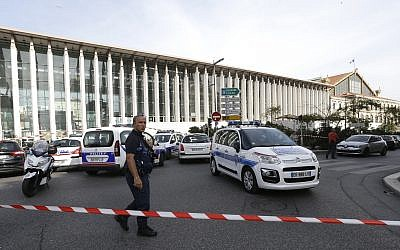 A French police officer cordons off the access to Marseille's main train station Sunday, Oct. 1, 2017 in Marseille, southern France. (AP Photo/Claude Paris)