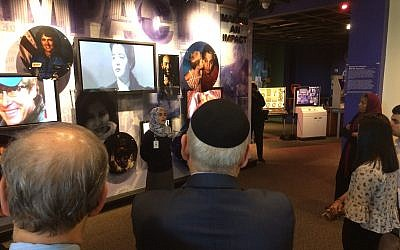 Members of the Muslim Jewish Advisory Council are welcomed to the Arab American National Museum in Dearborn, Michigan on Tuesday, Oct. 3, 2017. (AP Photo/Jeff Karoub)