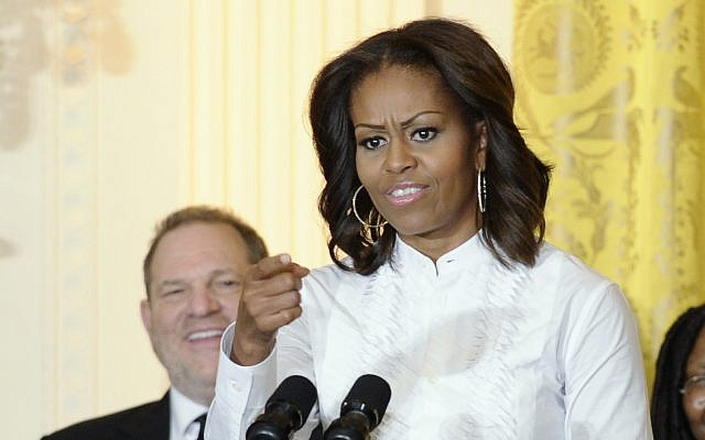 Movie mogul Harvey Weinstein listens as then-first lady Michelle Obama speaks in the East Room of the White House in Washington, November 8, 2013. (AP Photo/Susan Walsh)