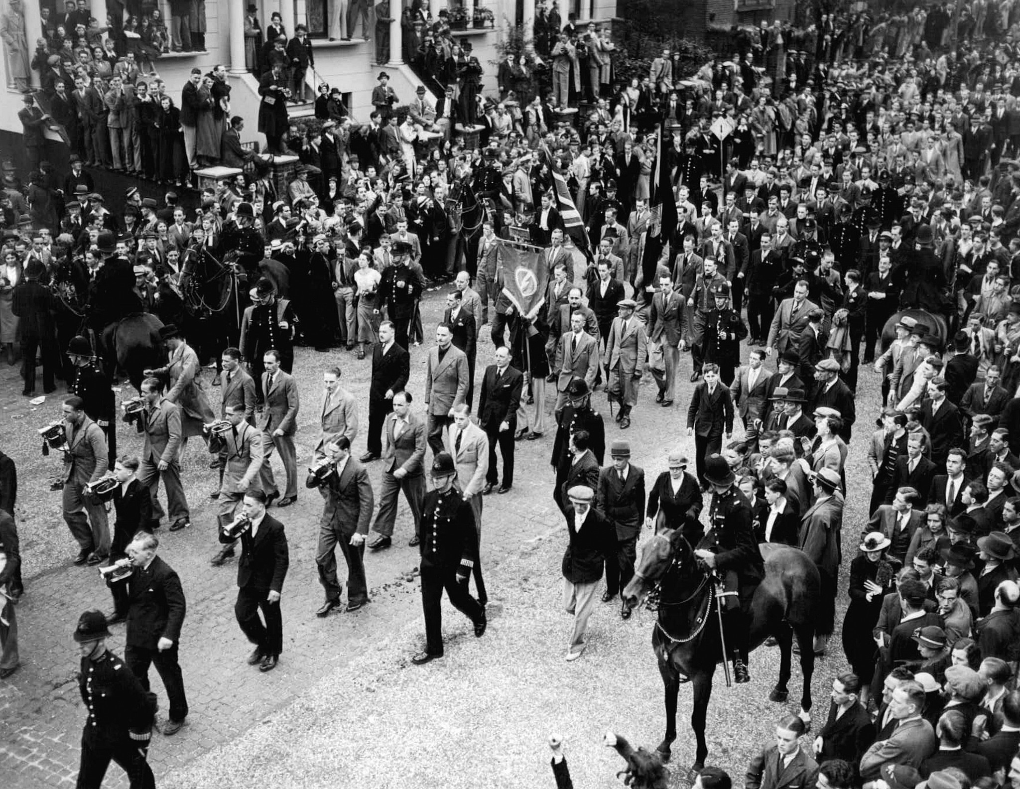 Illustrative: The start of the procession of the British Union of Fascists leaving Islip Street in Kentish Town, London, en route to Trafalgar Square, London, England July 4, 1937. Sir Oswald Mosley is seen in light suit, center of three marchers, immediately in front of the fascist banner. (AP Photo)