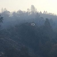Surrounded by blackened vegetation, Camp Newman's iconic hillside Star of David survived a wildfire in Northern California. (Courtesy of URJ Camp Newman)