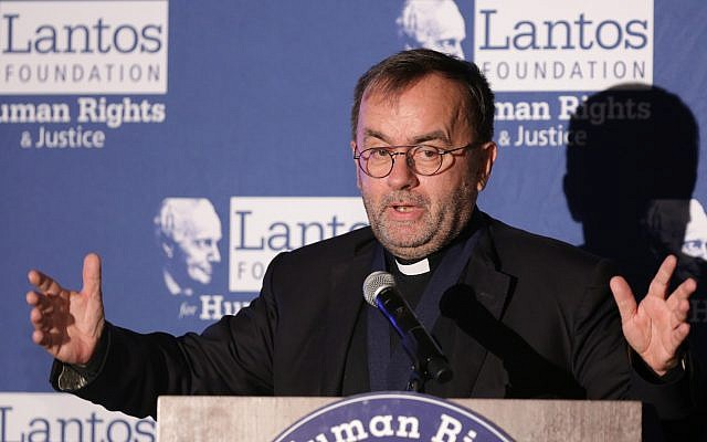 Father Patrick Desbois speaks after being awarded the Lantos Human Rights Prize on Capitol Hill in Washington, DC, on October 26, 2017. (Chris Kleponis)