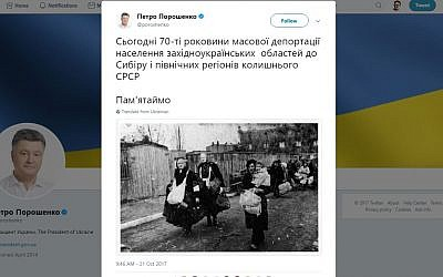 A tweet posted by Ukrainian President Petro Poroshenko about mass deportations carried out by Soviets against Ukrainians with a photo of Jews being deported by Nazis. (Screen capture: Twitter)