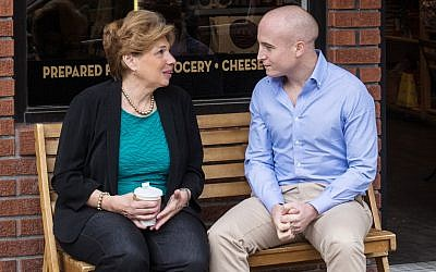 Max Rose, a Democratic candidate for the House seat representing Staten Island's 11th District, speaking with a constituent. (Courtesy)