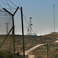 Fences, cell phone towers and water reseviors used by settlers in the West Bank, seen on November 29. 2006. (Illustrative photo: Olivier Fitoussi /Flash90)