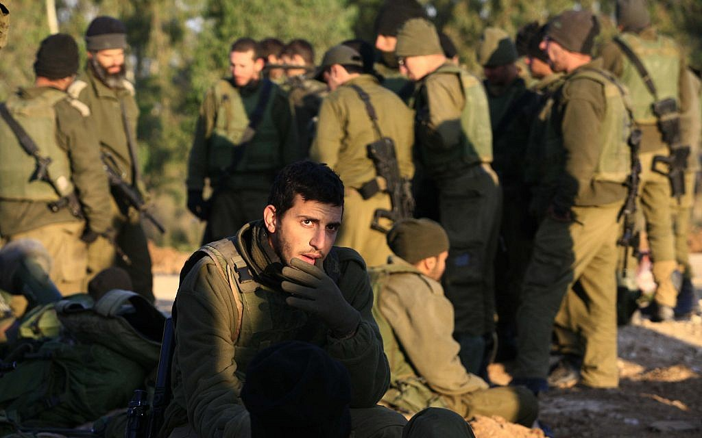 Illustrative image of Israeli infantry soldiers resting on their equipment early on 13 January 2009 (Nati Shohat/Flash90)