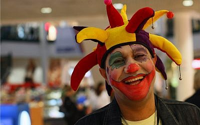 Illustrative image of an Israeli man dressed up as clown and laughing,  February 28, 2010. (Kobi Gideon/FLASH90)