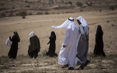 Illustrative: Residents of the unrecognized Bedouin village of Umm al Hiran walk to their homes after a protest against the town's demolition, on August 27, 2015. (Hadas Parush/Flash90)