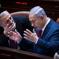 Prime Minister Benjamin Netanyahu, right, speaks with Interior Minister Aryeh Deri during a plenum session in the Knesset, January 11, 2016. (Miriam Alster/FLASH90)