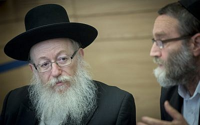 File: MK Moshe Gafni, right, and then-health minister Yaakov Litzman in the Knesset, September 6, 2016. (Yonatan Sindel/Flash90)