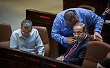 Illustrative: Prime Minister Benjamin Netanyahu speaks with coalition chairman David Bitan in the plenum on April 05, 2017. Tourism Minister Yariv Levin is seen on right. (Hadas Parush/FLASH90)