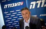 Avi Gabbay, seen at a press conference on July 11, 2017, the day after he won the Labor party leadership, with the party logo behind him. (Miriam Alster/Flash90)