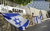 French Jews hold Israeli flags as they take part at a demonstration against UNESCO, near the cultural agency's Paris headquarters, July 17, 2017. (Serge Attal/Flash90)