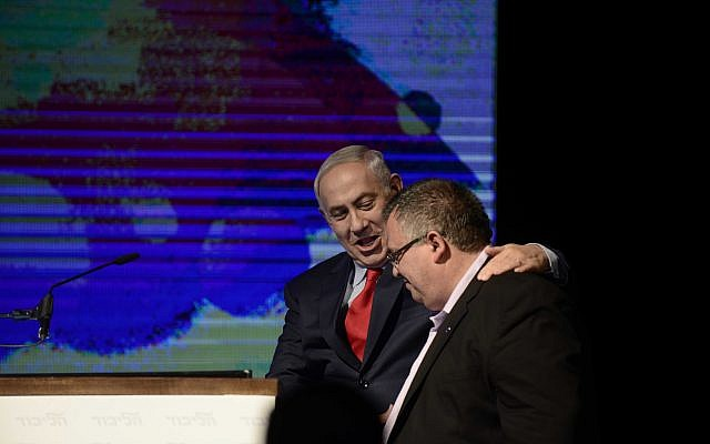 Prime Minister Benjamin Netanyahu with Likud party member Daivd Bitan at a rally in support of Prime Minister Benjamin Netanyahu, as he and his wife face legal investigations, in Tel Aviv, on August 9, 2017. (Tomer Neuberg/ Flash90)