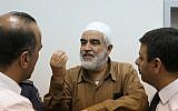 Leader of the northern branch of the Islamic Movement in Israel, Sheikh Raed Salah, arrives at the courthouse, August 21, 2017. (Flash90)